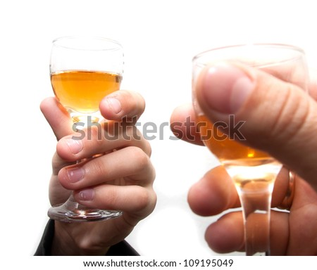 glasses of champagne in the hands of business people on white background