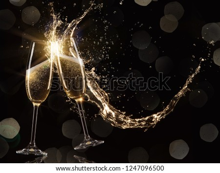 Glasses of champagne levitating in the air, celebration theme. #1247096500