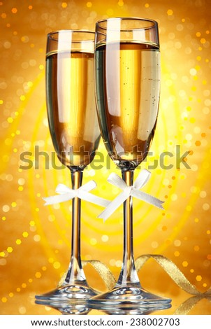 Glasses of champagne on bright background #238002703