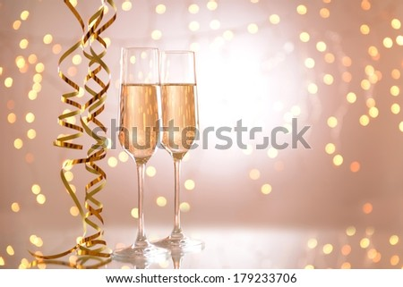 Glasses of champagne on shiny background #179233706