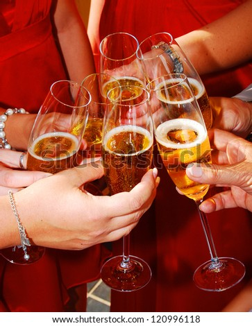 Glasses of champagne toasting together during party celebration event