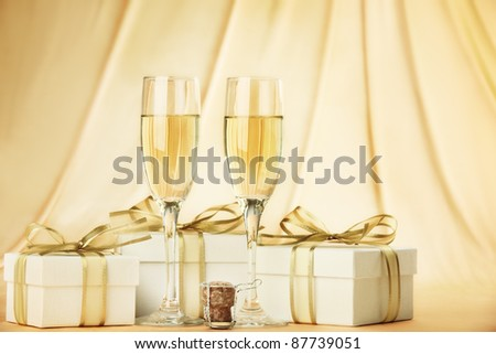 Glasses of champagne with gift boxes
