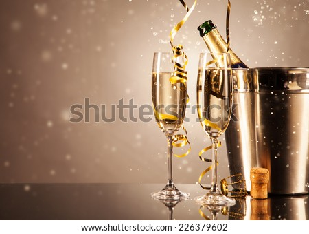 Glasses of champagne with ribbons and bubbles around. Concept of celebration #226379602