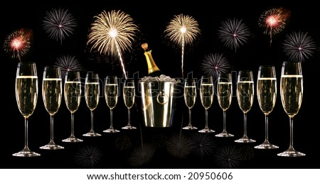 Glasses of champagne with silver ice bucket and fireworks