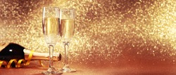 Glasses of champagne with splash, celebration theme concept