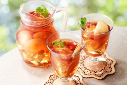 Glasses of cold ice tea with apple, ice, mint on background. Spring and summer drinks and beverages concept.