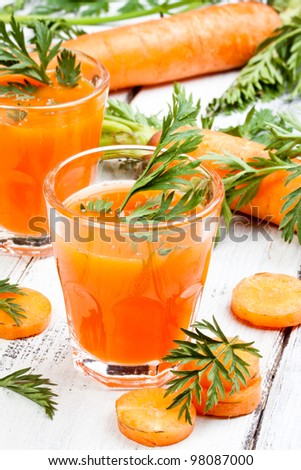 glasses of fresh and cold carrot juice