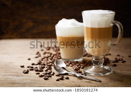 glasses of latte macchiato coffee on a wooden background Stock fotó ©