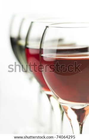 glasses of pink , red  and white wine , close up shot