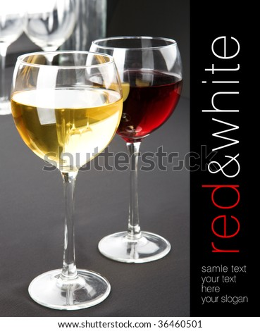 Glasses of red and white wine on grey background. Space for text isolated on black sidebar on right