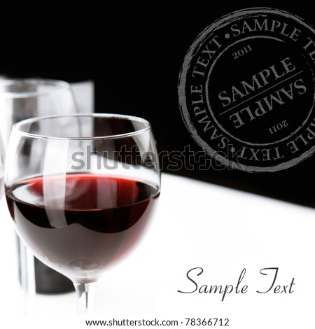 Glasses of red wine on white table cloth. Space for text isolated on white. Black background.