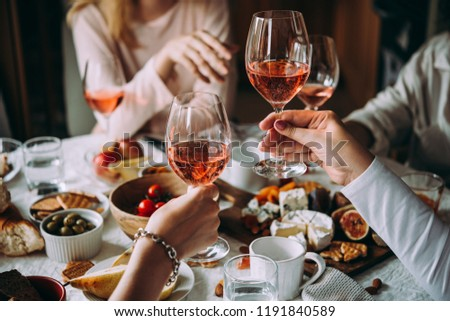Glasses of rose wine seen during a friendly party of a celebration. #1191840589