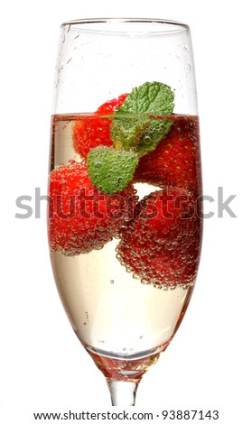 Glasses of sparkling wine and strawberry on white