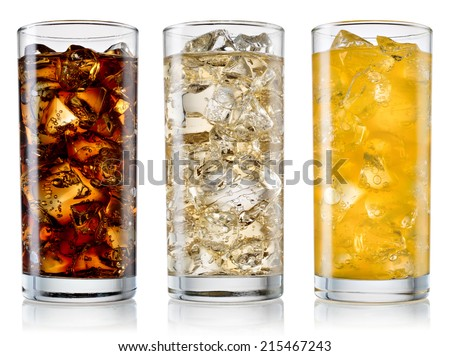 Glasses of sweet carbonated drinks with ice cubes isolated on white. With clipping path #215467243