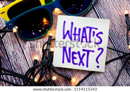 Glasses of two particular colors, lights in random directions, a question of What is next are present in the picture. Above note in the image asking about the future plans of a reader.