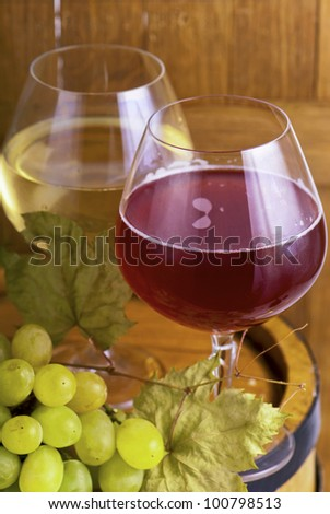 Glasses of white and rose wine and grapes over white