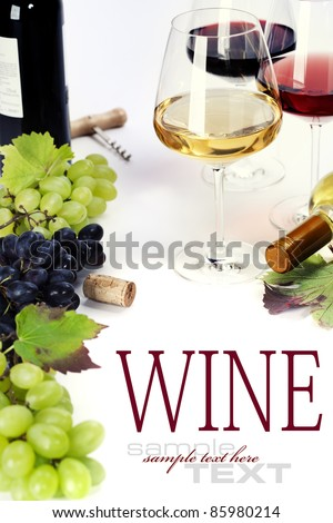 Glasses of white, red and rose wine and grapes over white (with sample text) - stock photo
