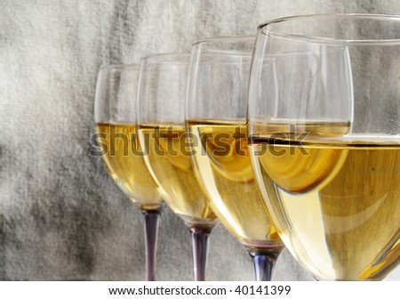 Glasses of white wine in a line