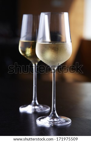 Glasses of white wine on table