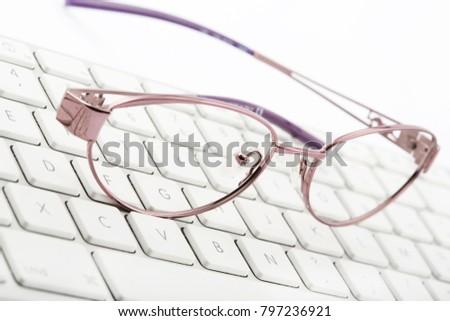 glasses on a keyboard #797236921