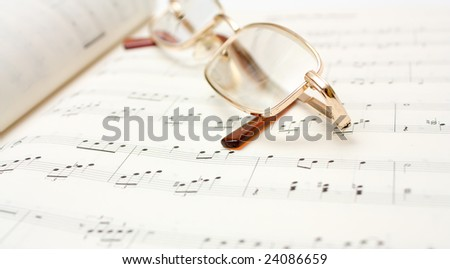Glasses on book of notes