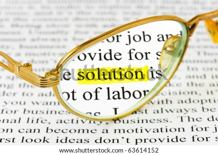 Glasses on business article and word solution