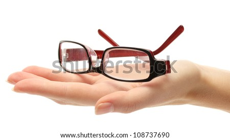 glasses on female hand, isolated on white