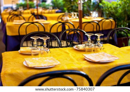 glasses on table - tables on the street, italian restaurant - Rome, Italy
