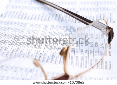Glasses on the financial newspaper.