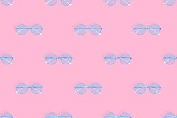 Glasses seamless pattern. Glasses for improving vision on a pink background.
