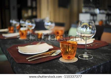 Glasses, Wine Glasses and plates on table in restaurant