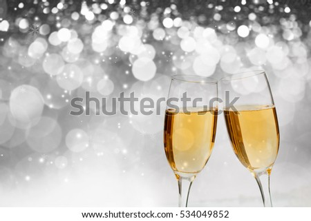 Glasses with champagne against holiday lights - New Year background #534049852