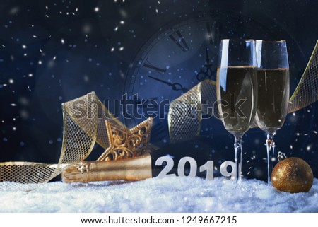 Glasses with champagne against vintage clock close to midnight. Christmas card #1249667215