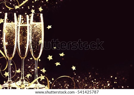 Glasses with champagne. New Year. #541425787