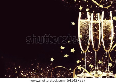 Glasses with champagne. New Year. #541427557