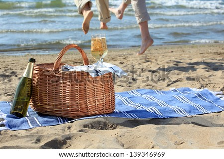 Glasses with champagne on a picnic basket