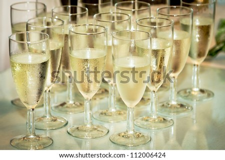 Glasses with champagne on the party table