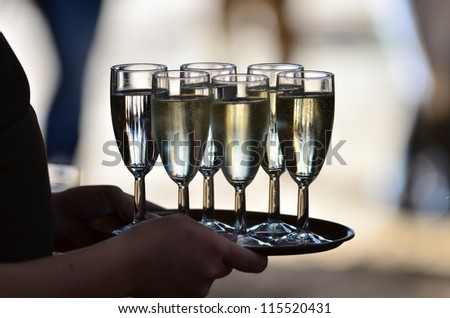 glasses with champagne served on a tablet