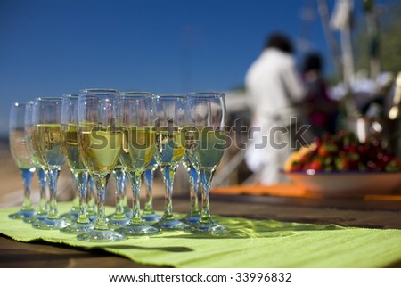 Glasses with champagne. Shallow depth of field. - stock photo