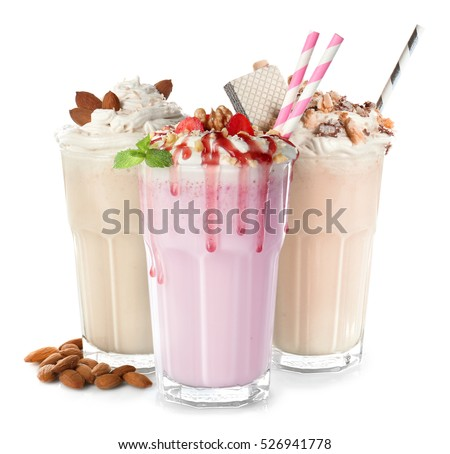 Glasses with delicious milk shakes on white background. Stock photo ©