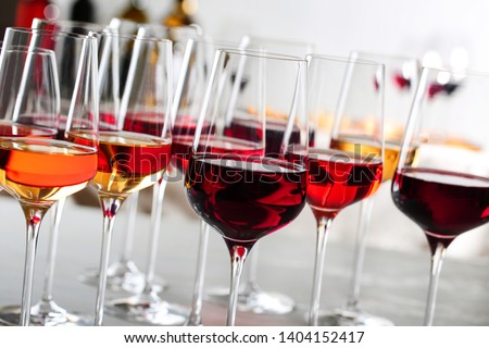 Glasses with different wines on blurred background, closeup #1404152417