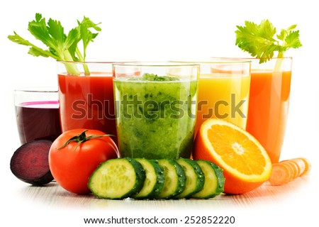 Shutterstock Glasses with fresh organic vegetable and fruit juices isolated on white. Detox diet.
