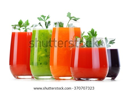 Shutterstock Glasses with fresh vegetable juices isolated on white. Detox diet.