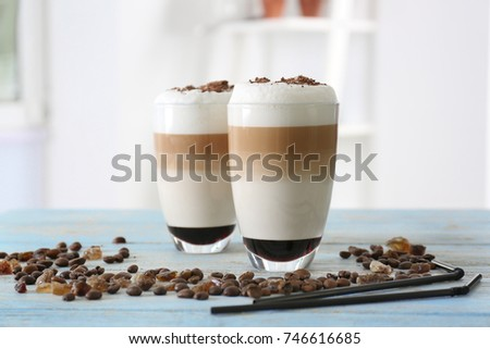 Glasses with latte macchiato on blurred background #746616685