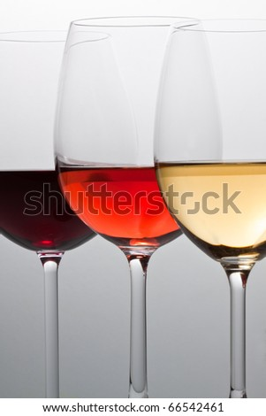Glasses with red, white and rose wine.