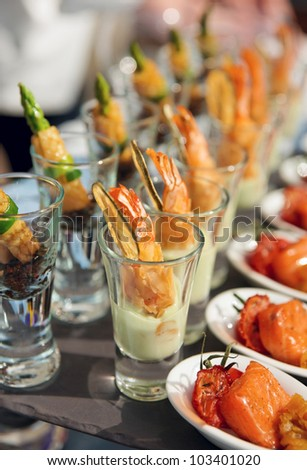 Glasses with seafood snacks -  banquet dish