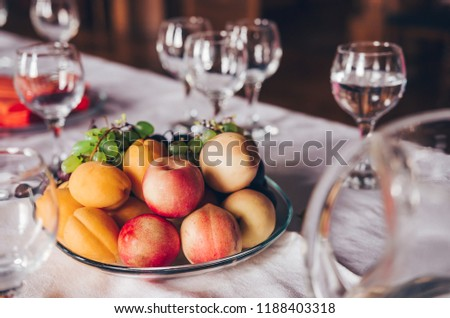 Glasses with water and fruits on the served table. Serving food and drinks at event #1188403318