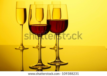 Glasses with wine on the color background