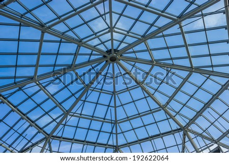 Glassroof of the building over blue sky #192622064