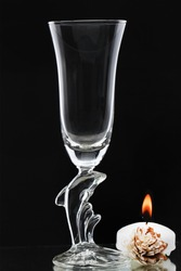 glassware products photography, glassware tumbler with light candle, tumbler with black background,glass dolphin,Luxuryglassware withbeautiful blurred background, for poster and banner